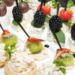 Canape with cheese and berries on a plate in a restaurant — Stock Photo