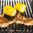 Grilling poultry quails in a restaurant — Stock Photo