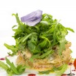 Salad with shrimp and arugula on a white background in the restaurant — Stock Photo