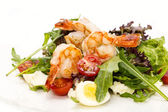 Salad greens and shrimp on a white background in the restaurant — Stock Photo