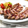 Roasted meat on the table in a restaurant — Stock Photo