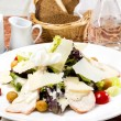 Caesar salad on the table in a restaurant — Stock Photo