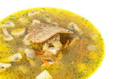 Suppe mit gemüse und pilzen in einem restaurant — Stockfoto