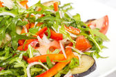 Salad of steamed zucchini on a white dish at restaurant — Stock Photo