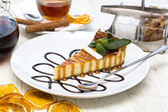 Piece of cheese cake on a table in a restaurant — Stock Photo