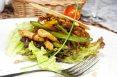 Salad with vegetables and meat on a white background in the restaurant — ストック写真