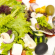 Stock Photo: Greek salad on a white background in the restaurant