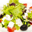Greek salad on a white background in the restaurant — Stock Photo