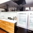 Stock Photo: Modern kitchen with top refrigerator