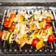 Skewers of seafood grilling — Stock Photo #30045765