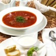 Red beet soup on the table in a restaurant — Stock Photo