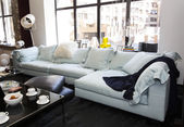 Large living room with comfortable sofas and furniture — ストック写真