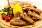 Chicken wings are grilled — Stock Photo