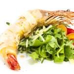 Постер, плакат: Jumbo shrimp with herbs and several types of tomatoes