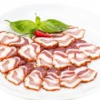 Bacon, onion and pepper on a plate in a restaurant — Stock Photo #32761931