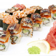 Japanese rolls in a restaurant with fish and vegetables — Stock Photo