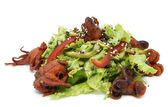 Salad of octopus and cabbage leaves — Stock Photo