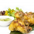 Chicken in curry with salad and sauce — Stock Photo