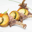 Roasted veal ribs with vegetables on a white plate  — Stock Photo