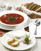 Red beet soup on the table — Stockfoto