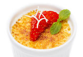 Creme brulee garnished with strawberries — Stock Photo