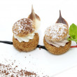 Profiteroles with vanilla ice cream decorated with chocolate mint — Stock Photo #35109211
