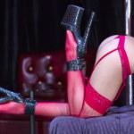 Girl in red lingerie dancing striptease — Stock Photo #35262367