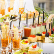 Canape with meat vegetables and seafood — Stock Photo #35262883