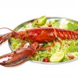 Lobster on a plate with a lemon lime — Stok fotoğraf