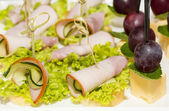 Canape with meat vegetables and seafood — Stock Photo