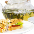 Sandwich with tea — Stock Photo