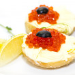 Canape with red caviar and lemon  — Stock Photo