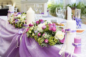 Table ware glass glasses and fresh flowers — Stock Photo
