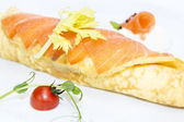 Scrambled eggs with cheese and salmon decorated with tomato — Stock Photo