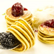 Sweet little pancakes with blackberry jam — Stock Photo