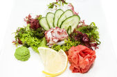 Japanese cuisine sashimi with vegetables and fish — Stock Photo