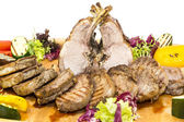 Loin and steak cooked on a grill with vegetables — Stock Photo