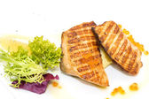 Grilled salmon fillet with vegetables and caviar — Stock Photo