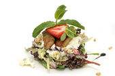 Salad of meat and greens adorned with strawberries — Stock Photo