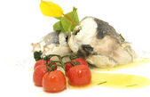 Baked fish with cherry tomatoes — Stock Photo
