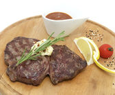 Steak grilled with lemon and tomato sauce — Stock Photo