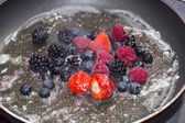 Cooking berries in a pan — Stock Photo