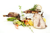 Roasted rabbit meat and potatoes with vegetables — Stock Photo