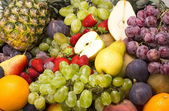 Background of ripe fruit apples oranges grapes — Stock Photo