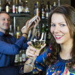 Girl near the bar and the bartender — Stock Photo #40116983