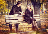 Boy and a girl in the autumn park — Foto Stock