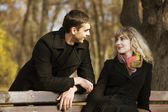 Boy and a girl in the autumn park — Stock Photo
