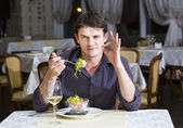 Young man having dinner — Stock Photo