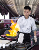 Japanese chef preparing a meal — Stock Photo
