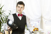 Waiter with a tray of food — Stok fotoğraf